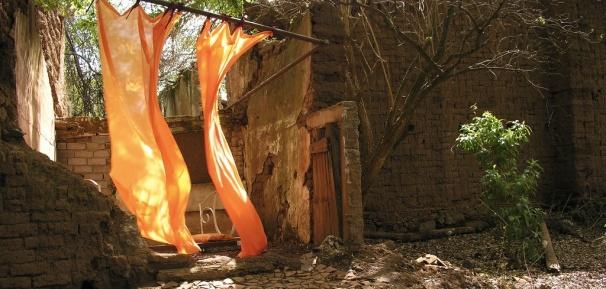 Sameena Sitabkhan (INDIA/USA) installation in adobe stables.